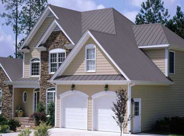 Nice Example Of A Two Story House With Metal Roofing