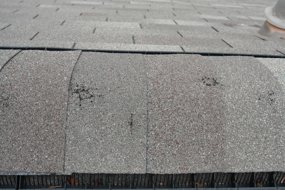 Virginia roofing siding company hail damage repair for Hail damage vinyl siding