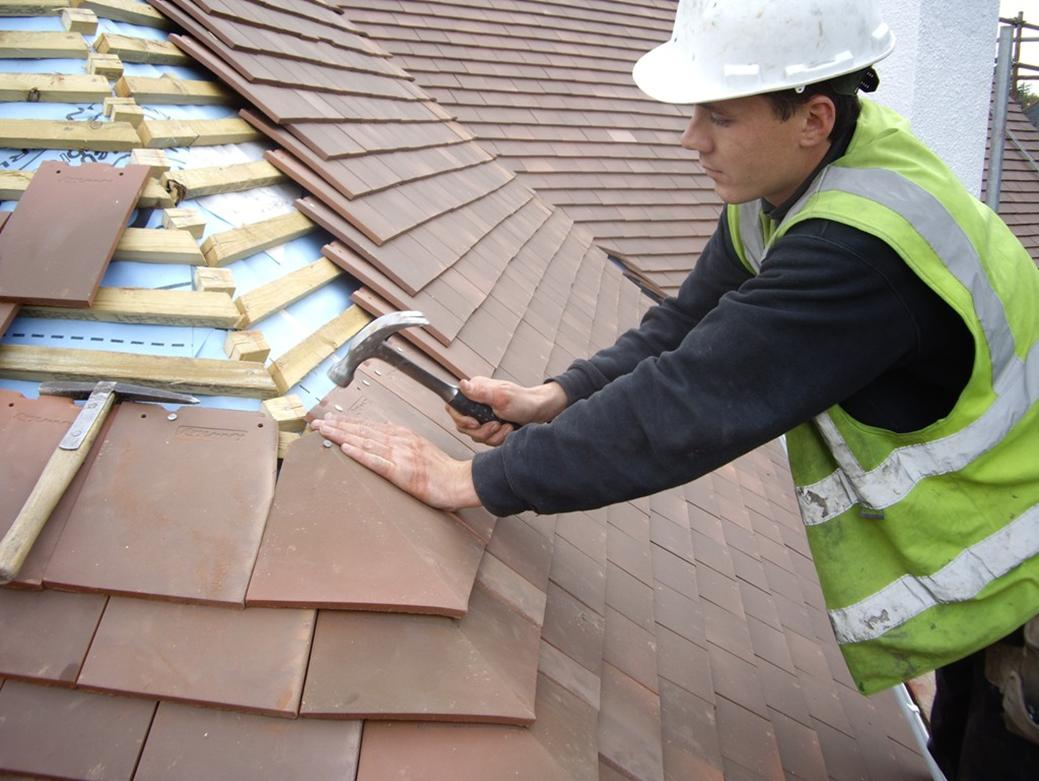 How You Can Keep Any Roof In Ideal Condition Virginia-Based-Roofing-Repair-Contractors-In-Action-On-top-Of-Roof