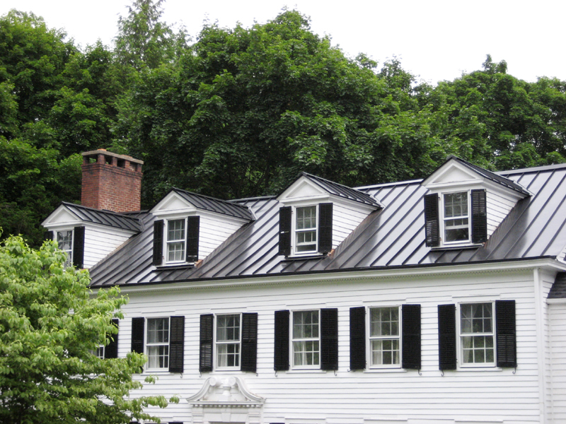 Virginia roofing siding company metal roofing for Homes with metal roofs photos